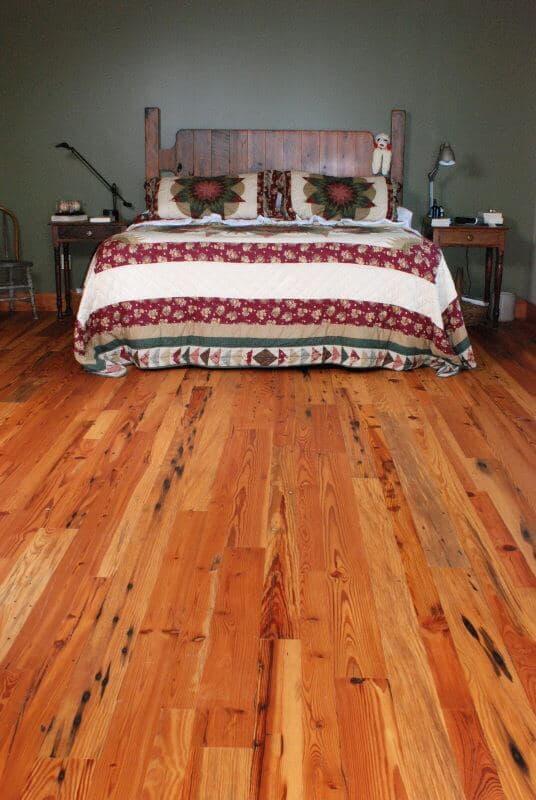 Antique heart pine cabin grade in a bedroom