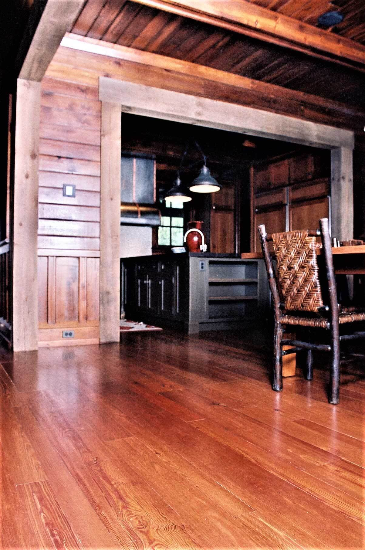 an Antique heartpine floor and a black cane chair in lake toxaway, nc