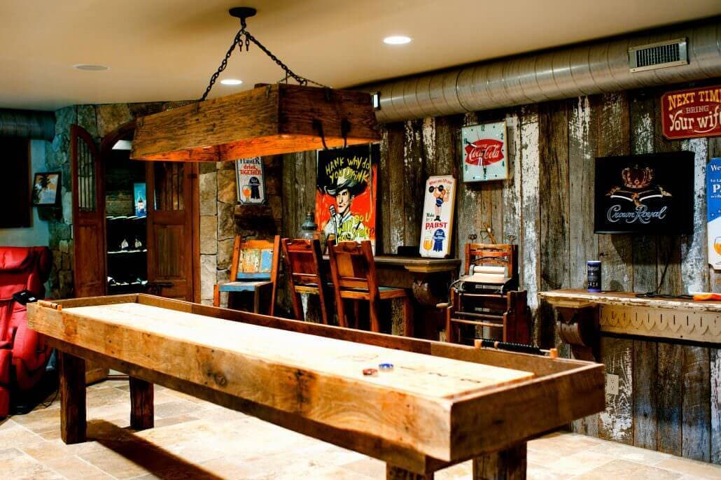 painted siding and barn wood around a game table in a hickory nc basement man cave