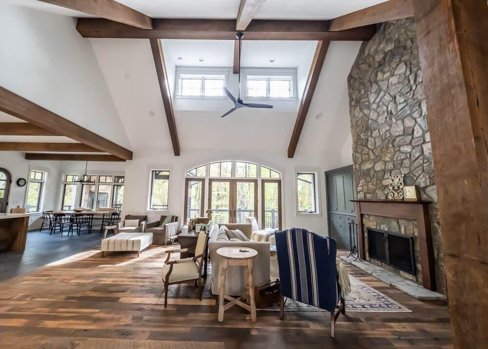 Reclaimed wood beams in lofted great room.