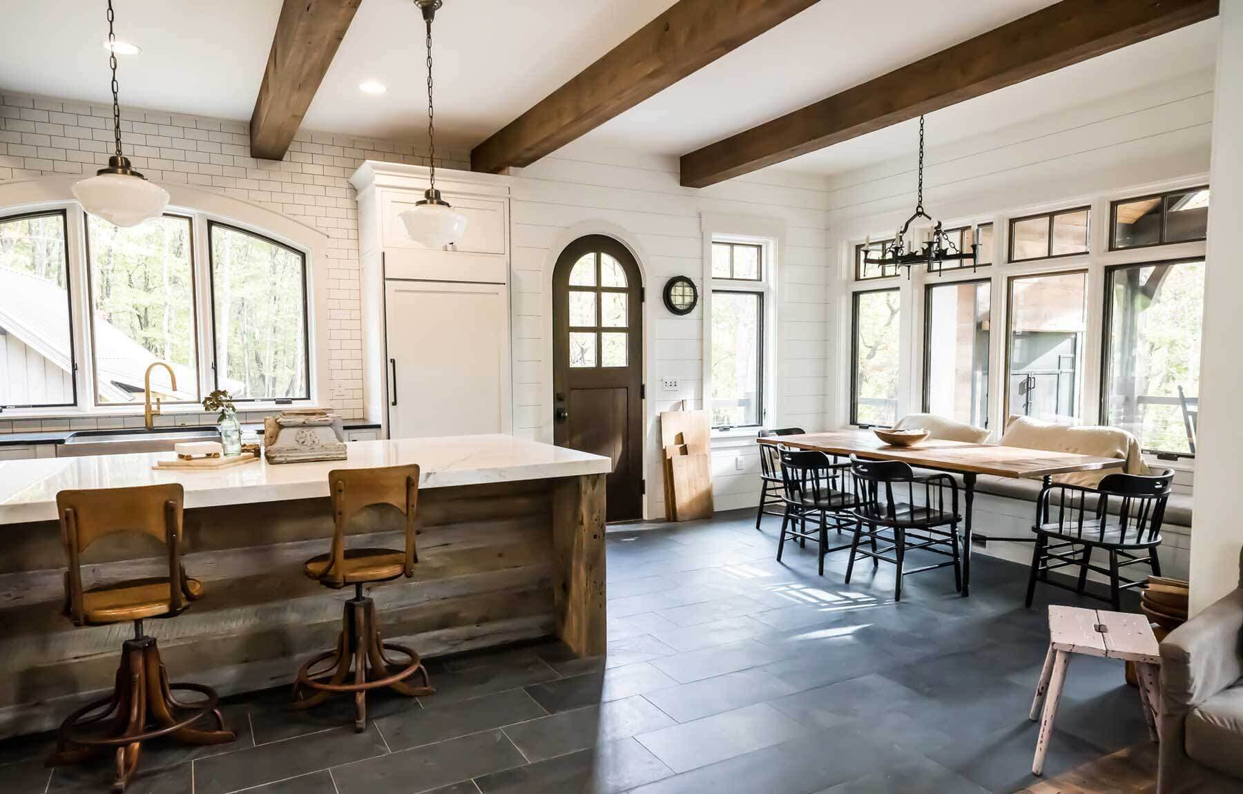 Rustic circular sawn reclaimed wood box beams installed in kitchen and dining ceilings.