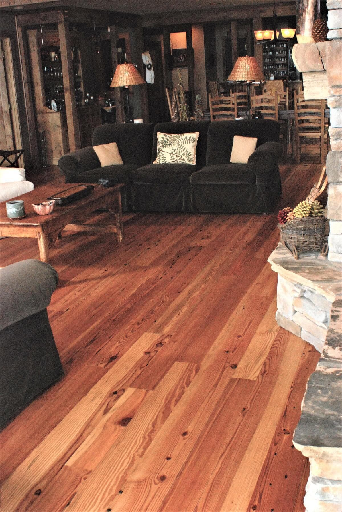 heart pine Cabin grade floor and a sofa in hendersonville nc