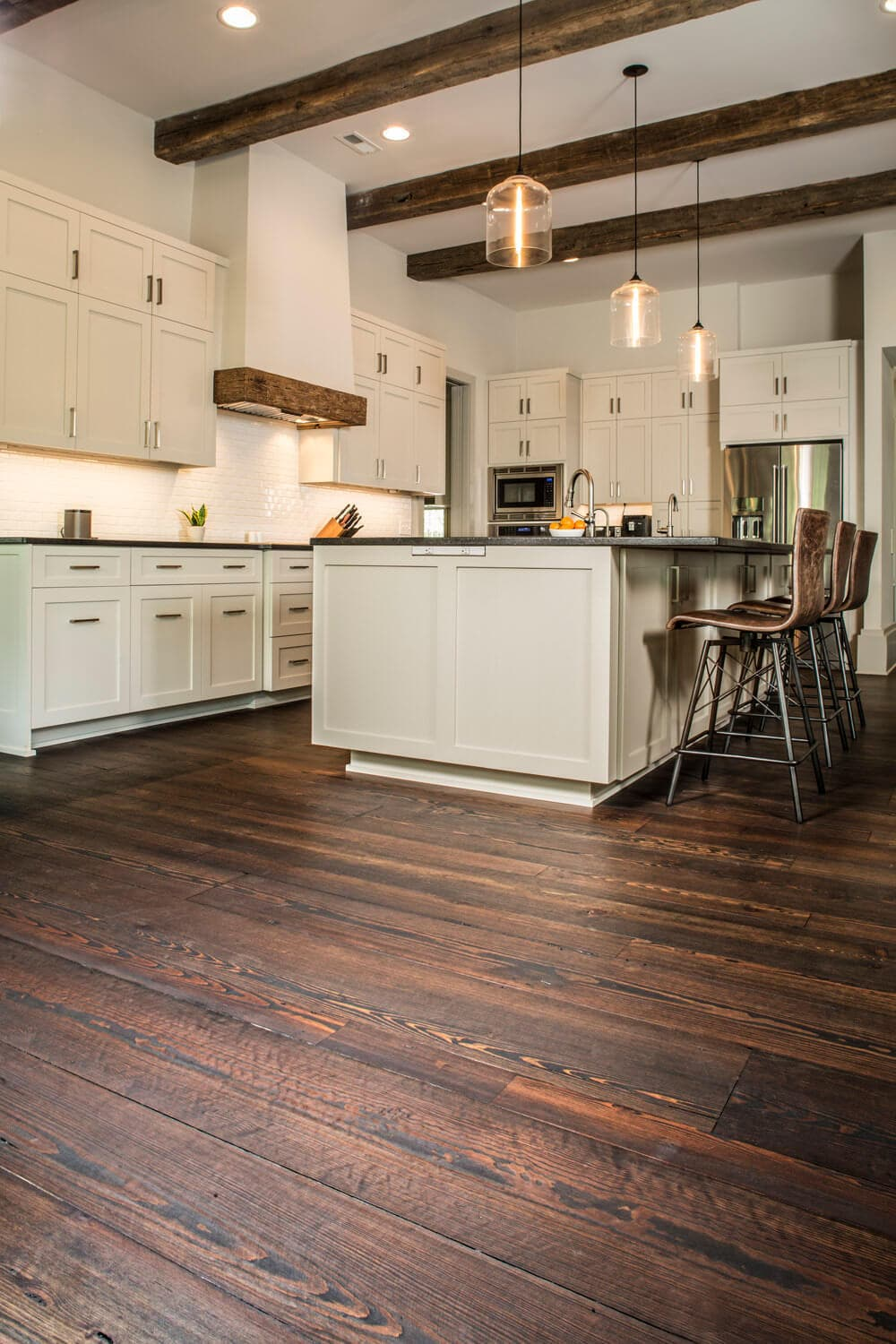 wide plank engineered floor and ceiling beams in a kitchen