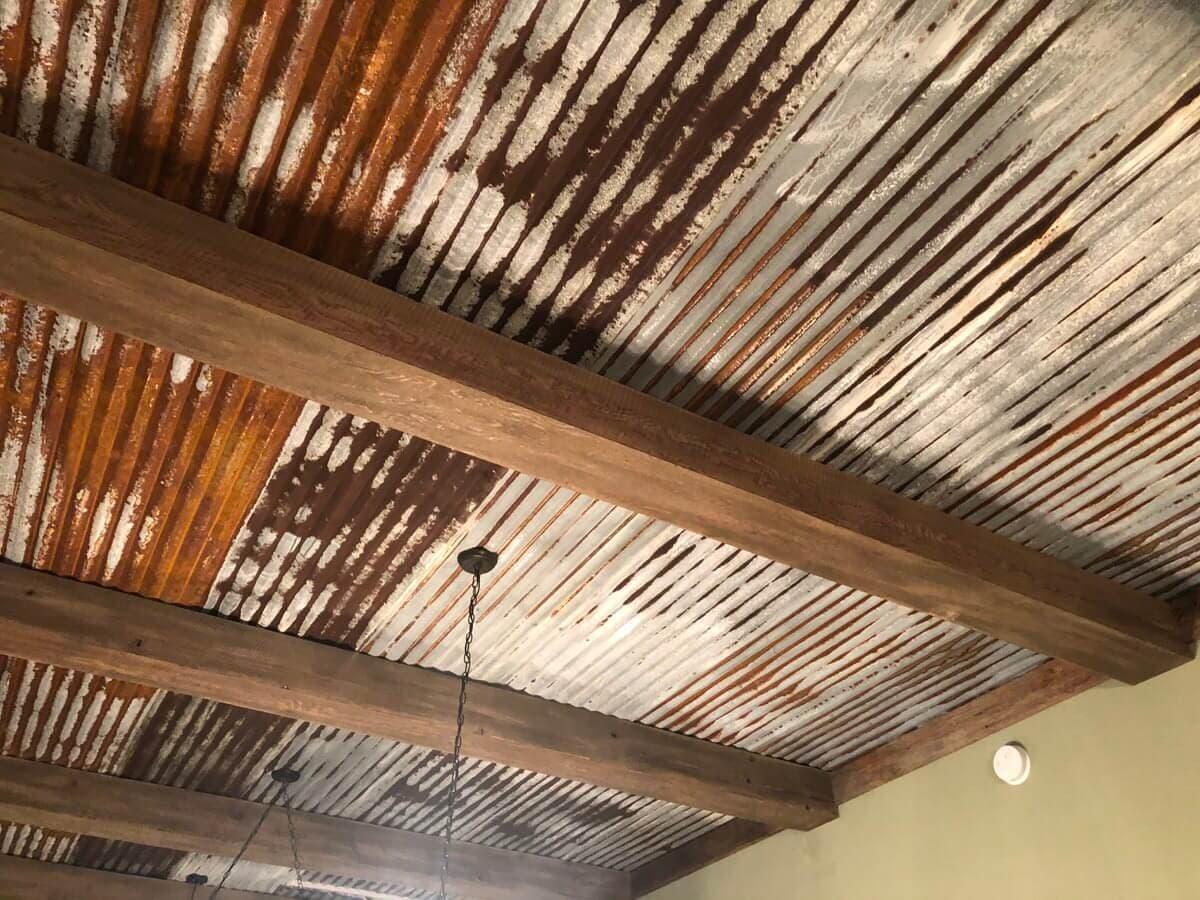 Circle sawn Doug Fir box beams and a rusty tin ceiling
