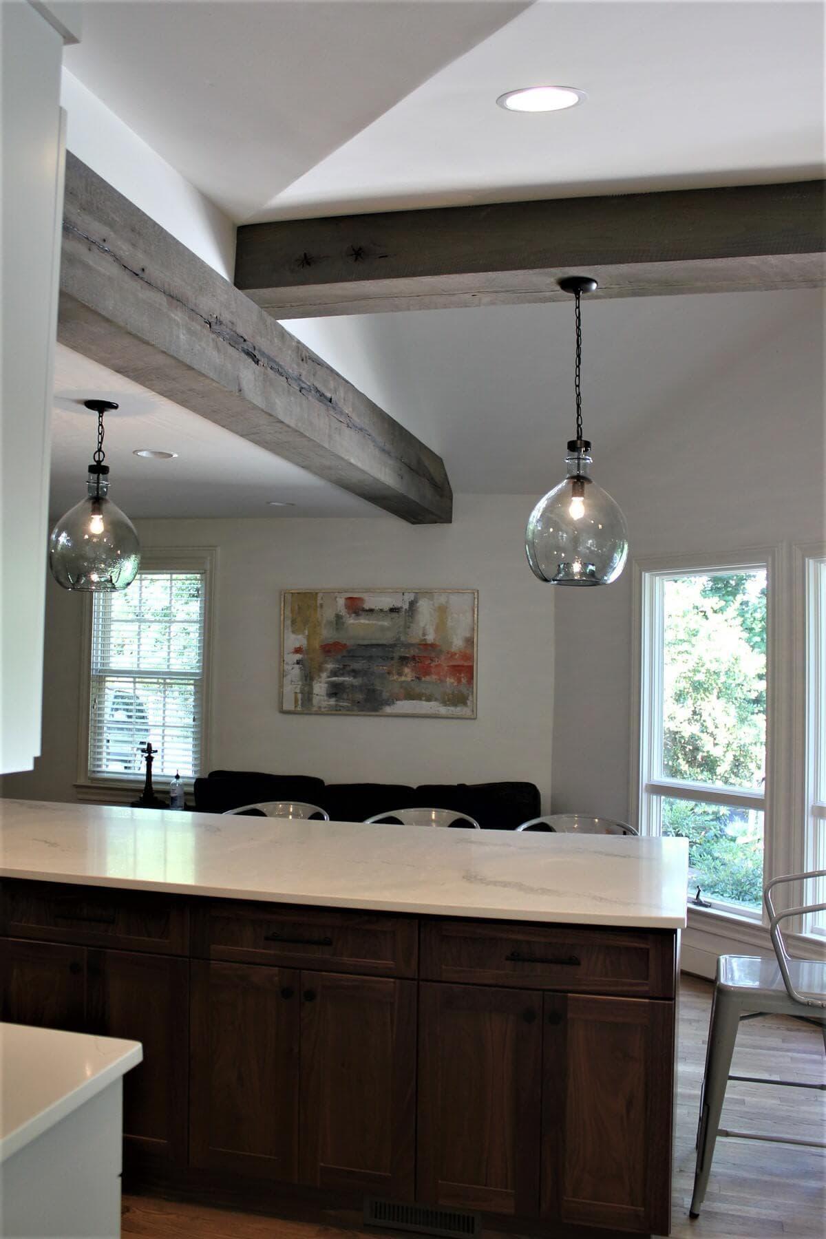 two Circle sawn box beams at angles in a kitchen