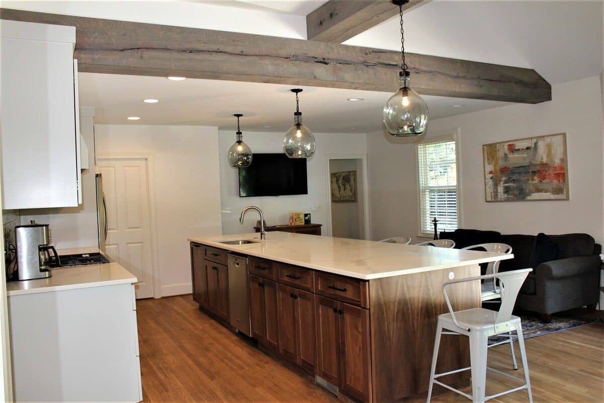 Circle sawn box beams on kitchen ceiling frame a T angle