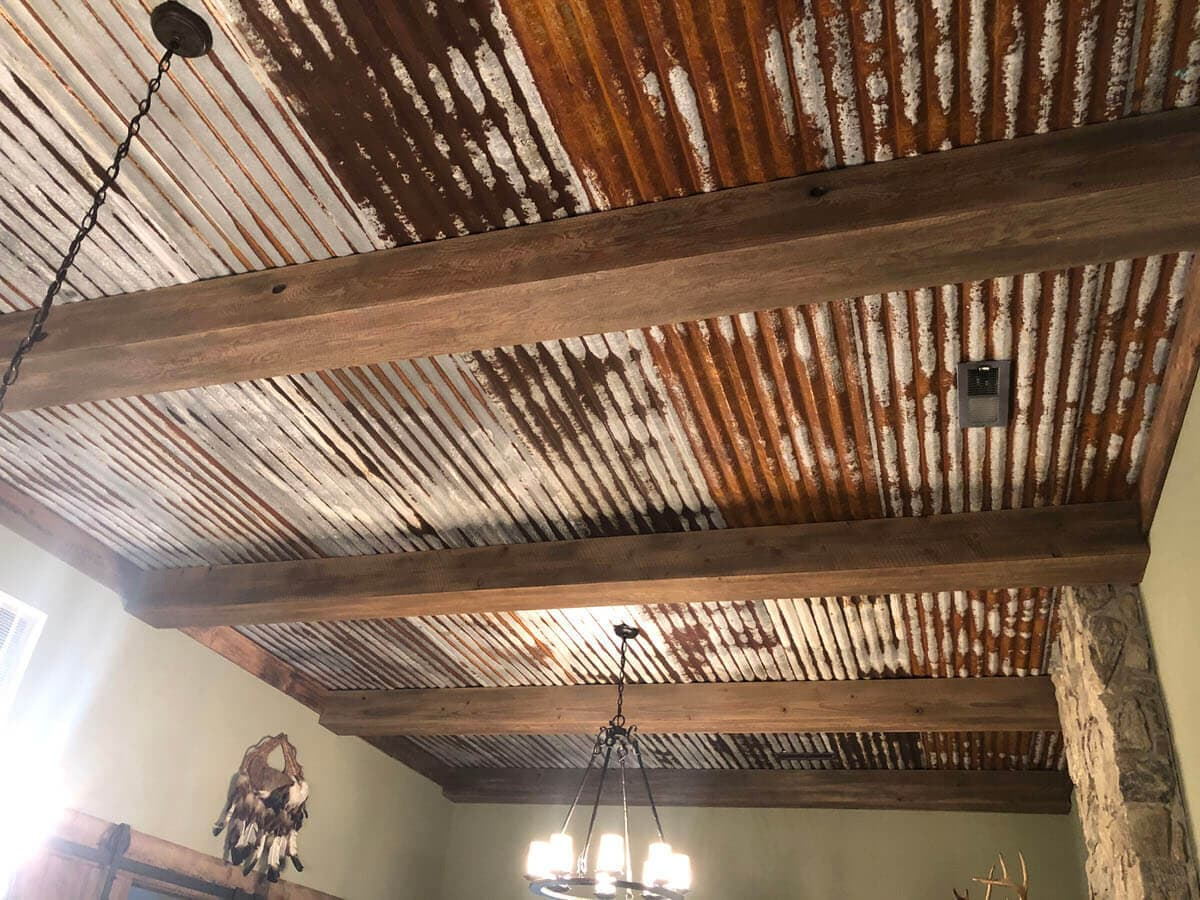 Circle sawn Doug Fir beam wraps and reclaimed tin ceiling