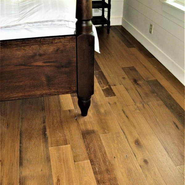 Smooth reclaimed White Oak flooring in bedroom.