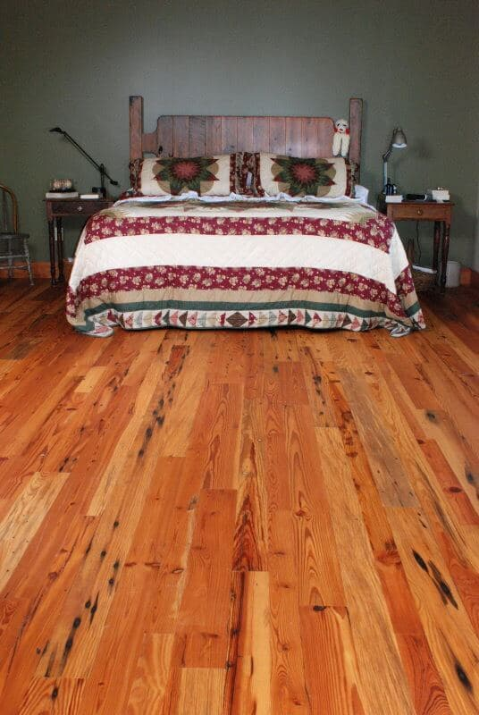 Classic old wood flooring restored for bedroom.