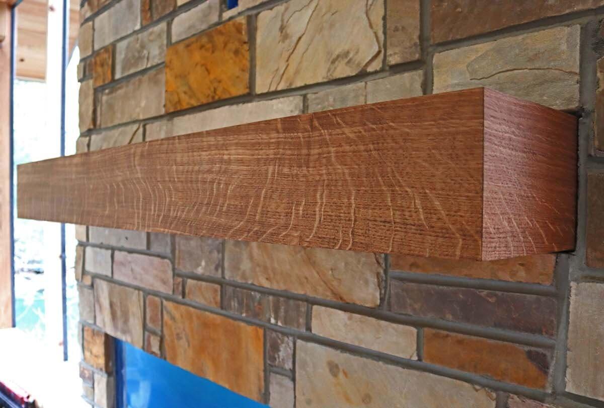 reclaimed oak box mantel over a brick fireplace on Lake Summit near Hendersonville, NC