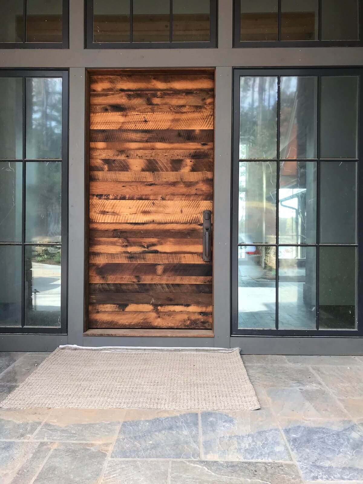 Stunning modern reclaimed wood front door engineered to perfection.