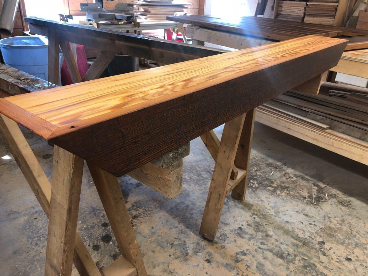 reclaimed heart pine mantel in isosceles trapezoid shape in wood shop