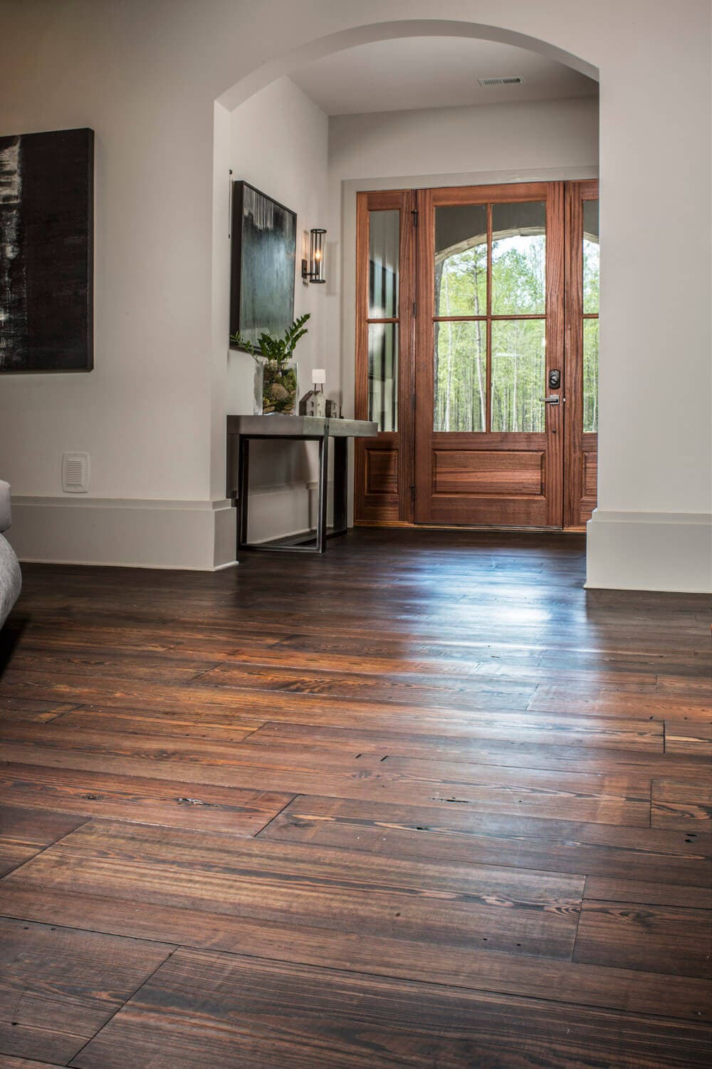 plain sawn heart pine floor with a view to the front door