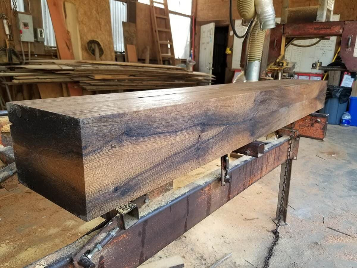 Smooth planed engineered reclaimed oak box mantel in the shop