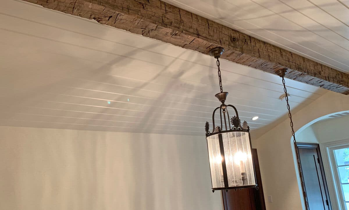 Hand hewn box beam with hanging fixture and hidden cords