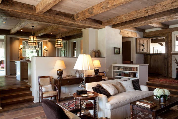 Hand hewn beams frame a living area in Tryon NC
