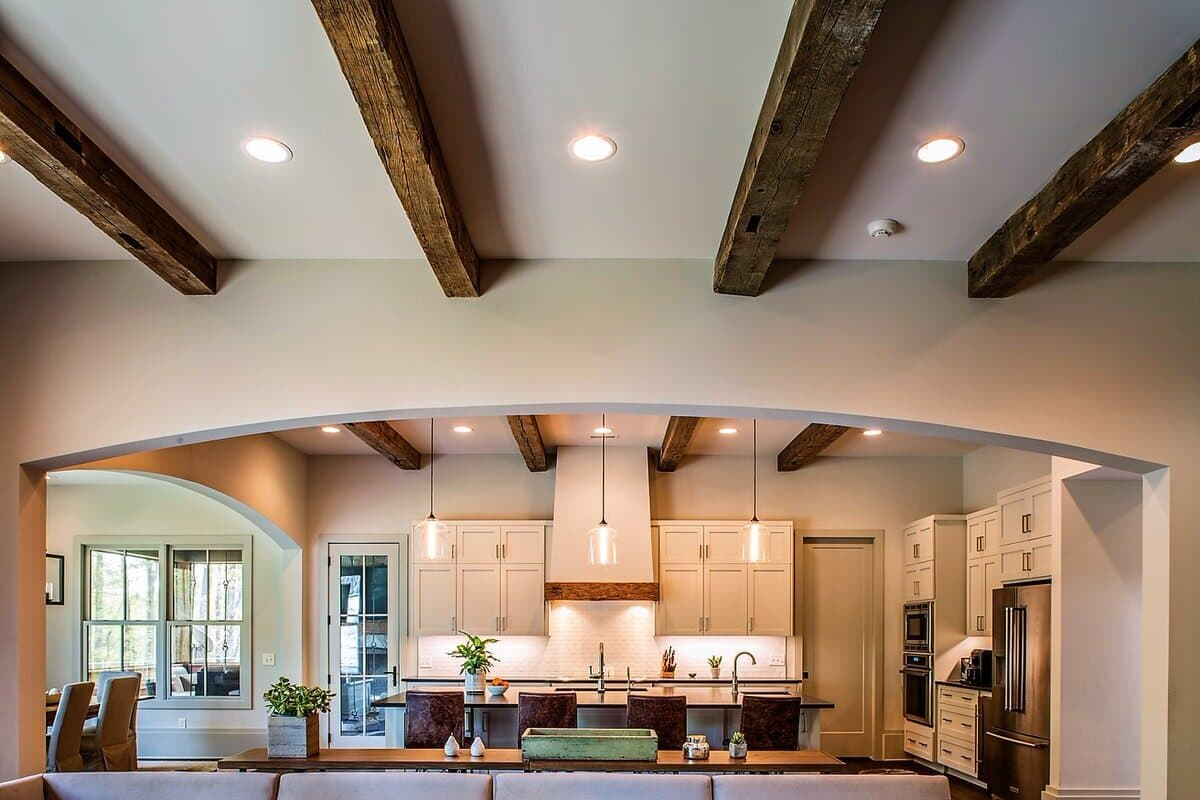 Hand hewn box beam ceiling beam style above kitchen.
