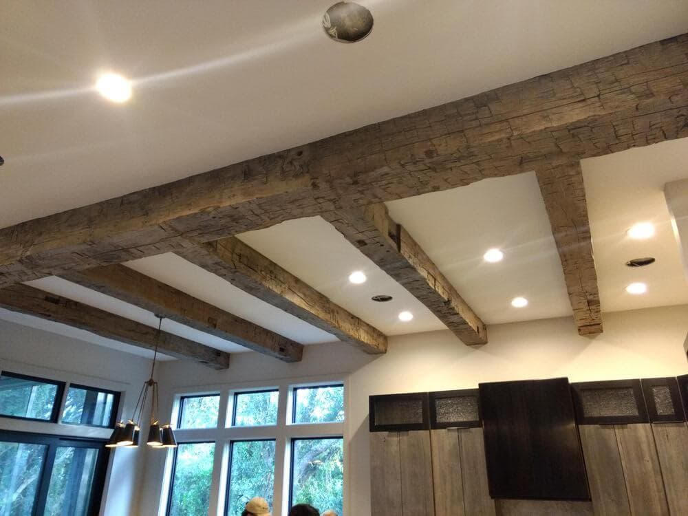 Hand hewn ceiling beams with a horizontal header