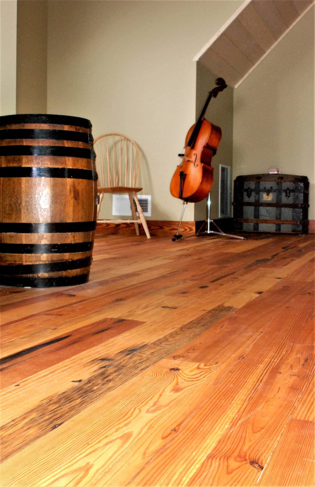 Heart pine flooring in a room with a cello hendersonville nc