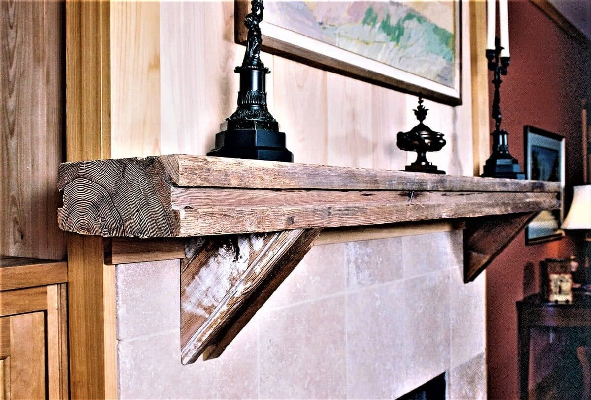 heart pine original surface mantel with small corbels and unfinished.