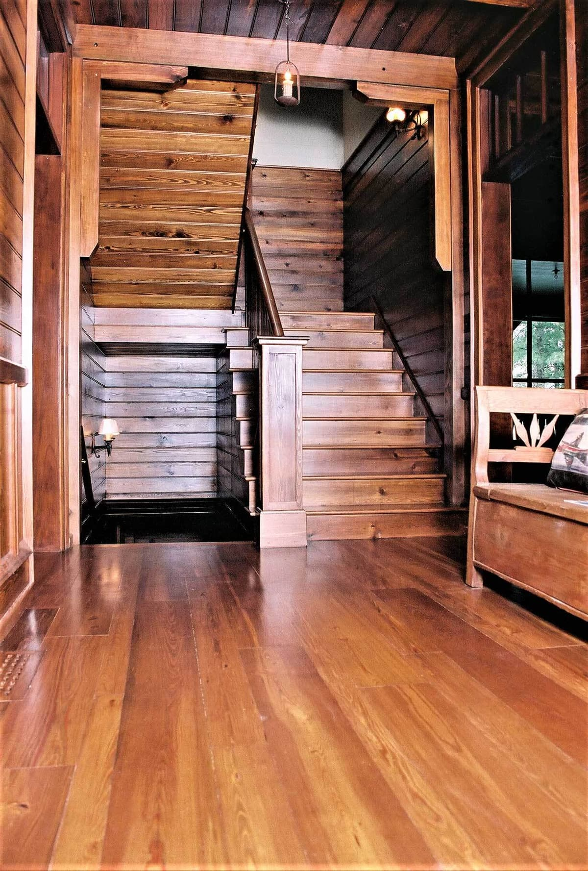 Reclaimed heart pine wood stair treads and landing in Lake Toxaway North Carolina.