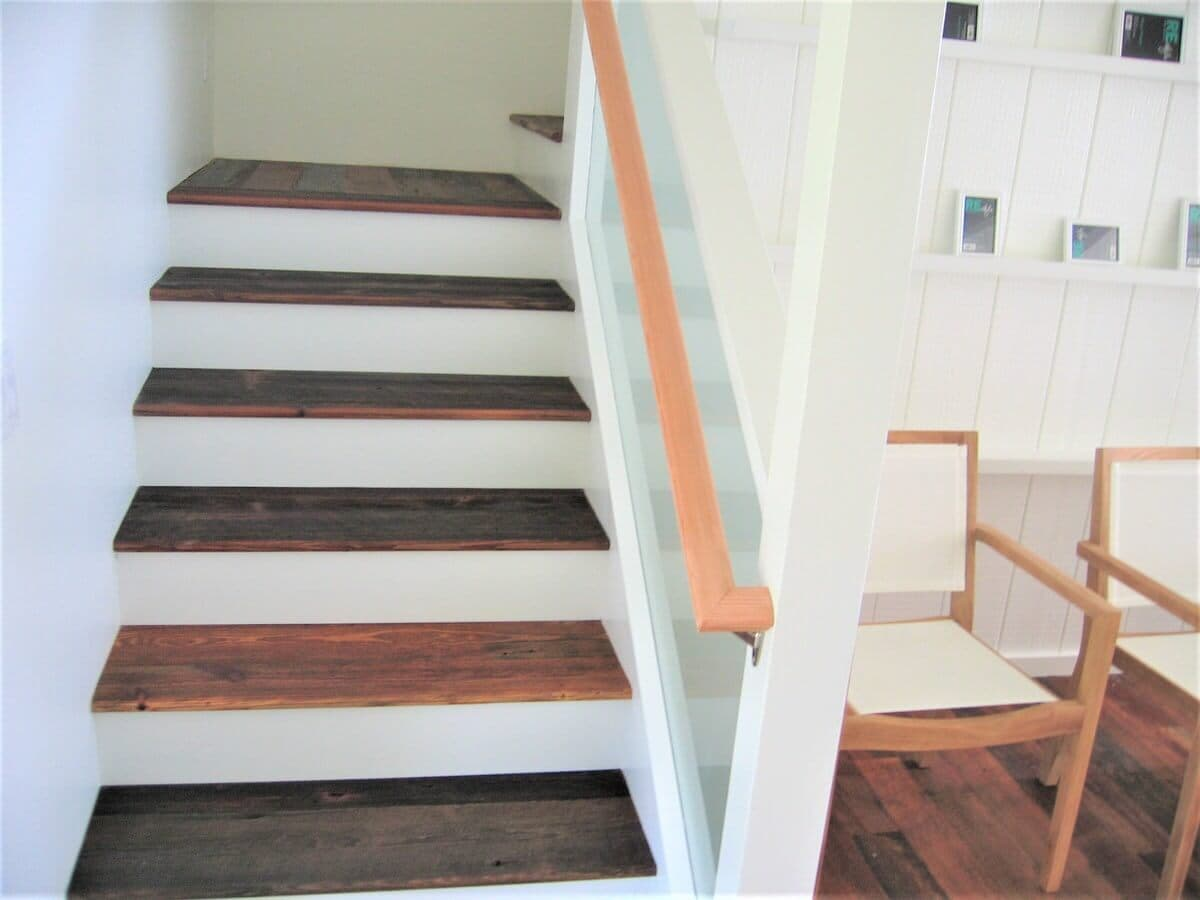 Heart pine stair treads on white wood risers and walls in hawaii