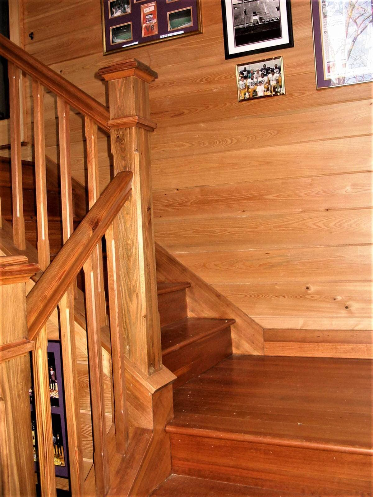 heart pine stairway landing, post and banister with heart pine  horizontal wall cladding