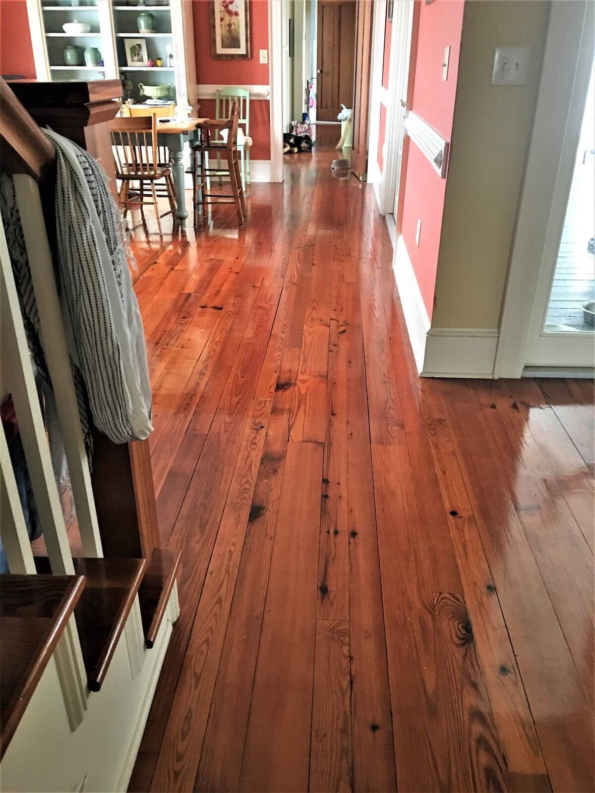 Heart pine plain sawn  flooring in a pink room in East Amherst, ny