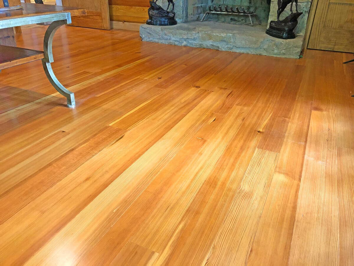 prime grade heart pine vertical grain floor angled left from a fireplace
