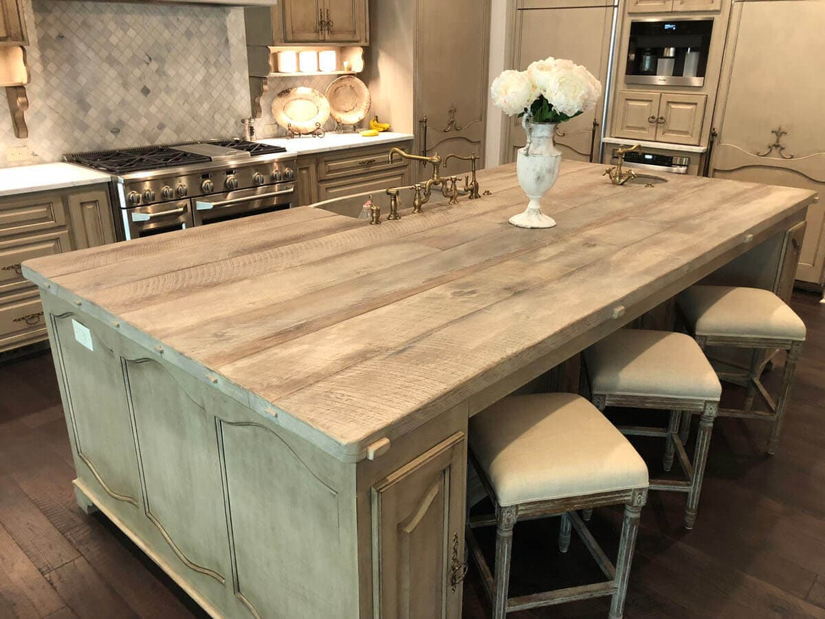 gray brown character oak Kitchen Sink Counter with 3 tan leather top stools