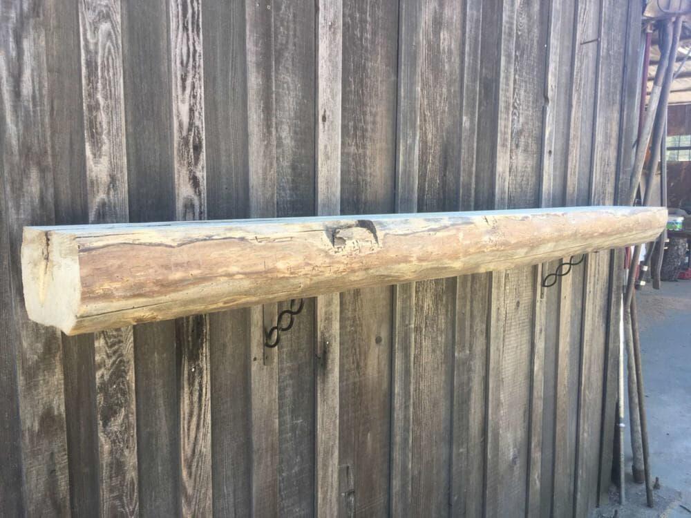 Live edge rustic Ash Mantel for sale measuring 1030 x 773.