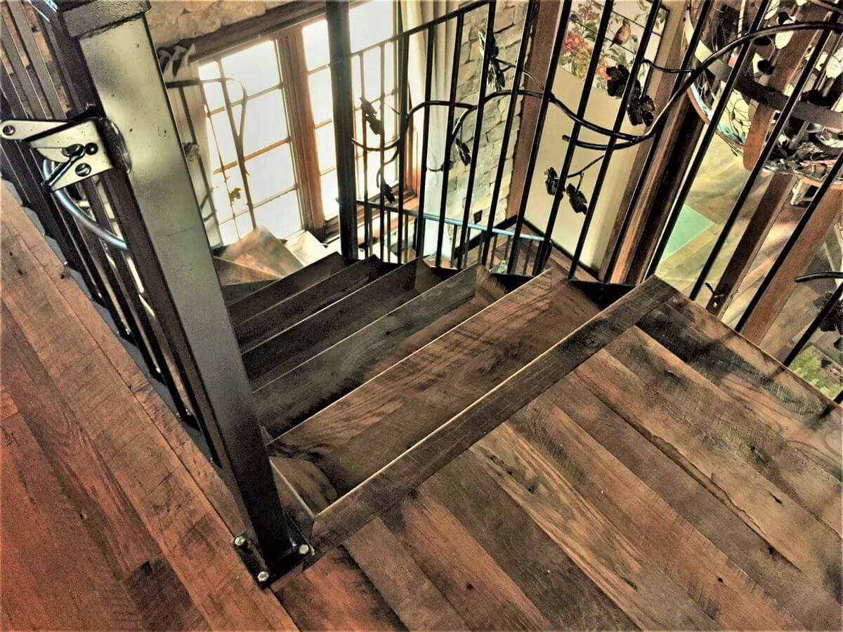 character reclaimed oak stairway and ironwork rails in lake toxaway, nc