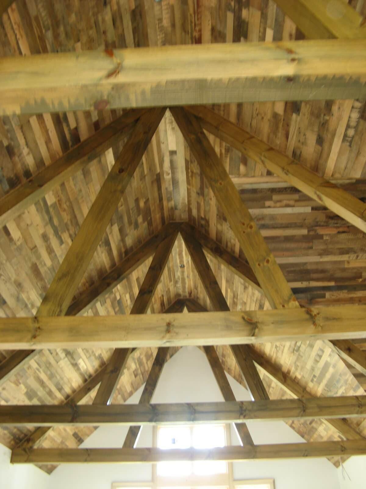 Reclaimed oak ceiling and rustic pine trusses in hendersonville nc