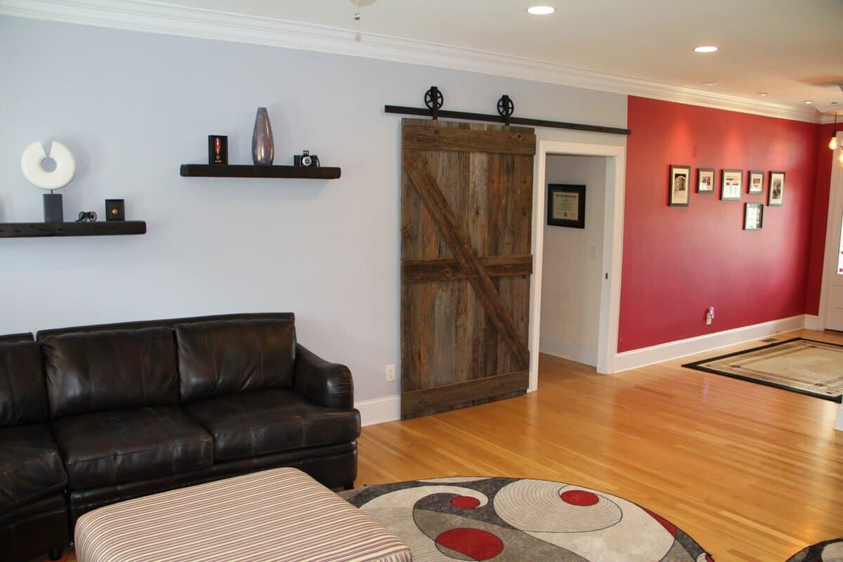 original surface georgia pine sliding barn door and red wall