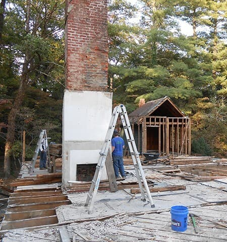 Reclaiming brick from old chimney.