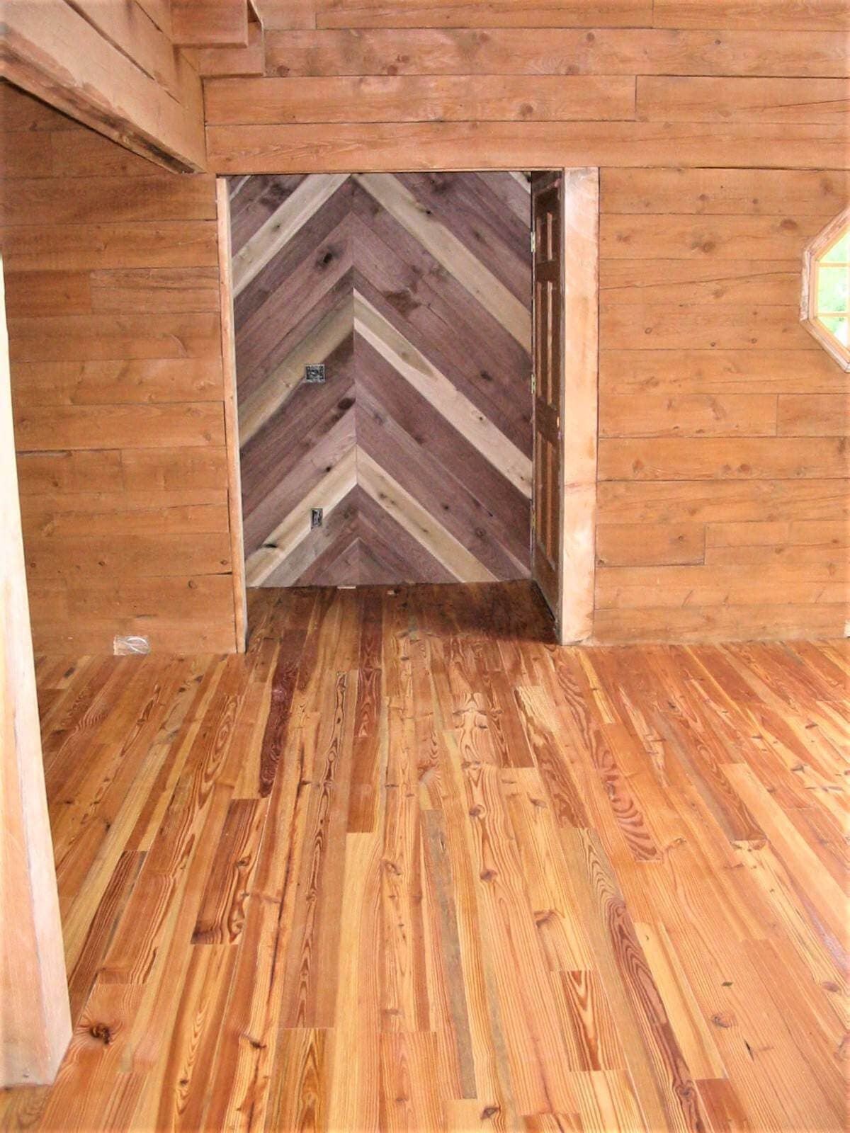 Reclaimed walls and cabin grade heart pine in Henderson County NC