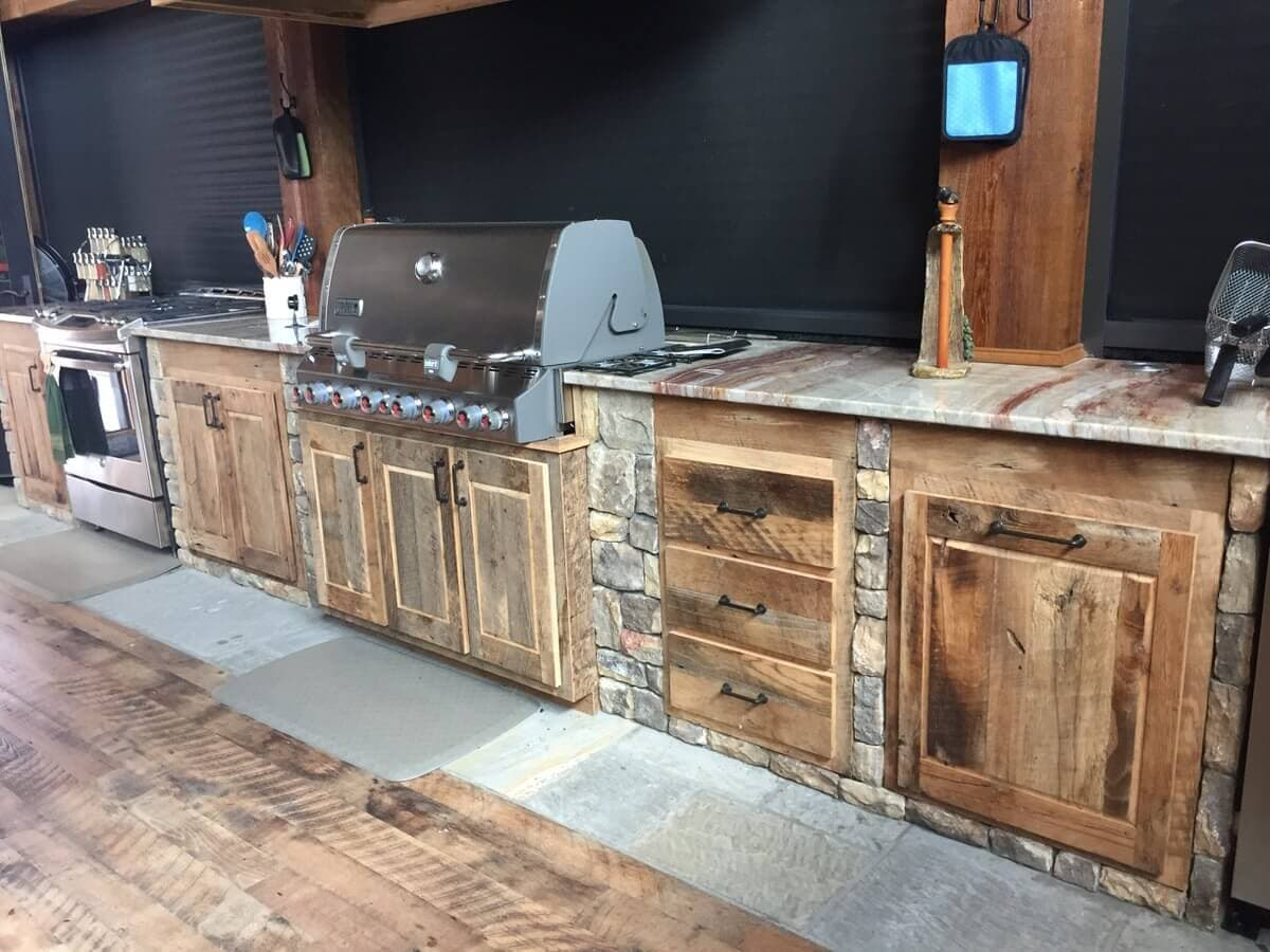 Reclaimed wood cabinets in an outdoor kitchen