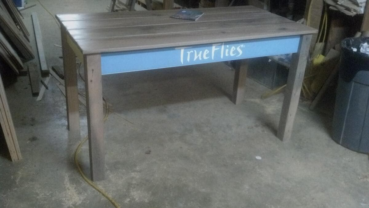 Reclaimed display tables for True Flies Inc