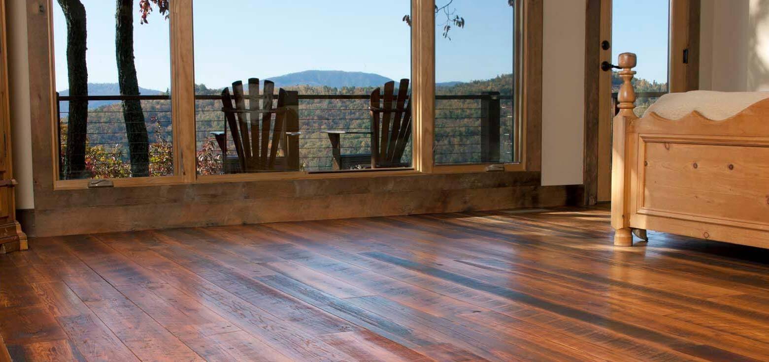 Reclaimed engineered wood flooring in bedroom.