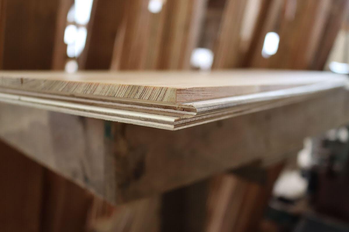 Reclaimed engineered floor board up close.
