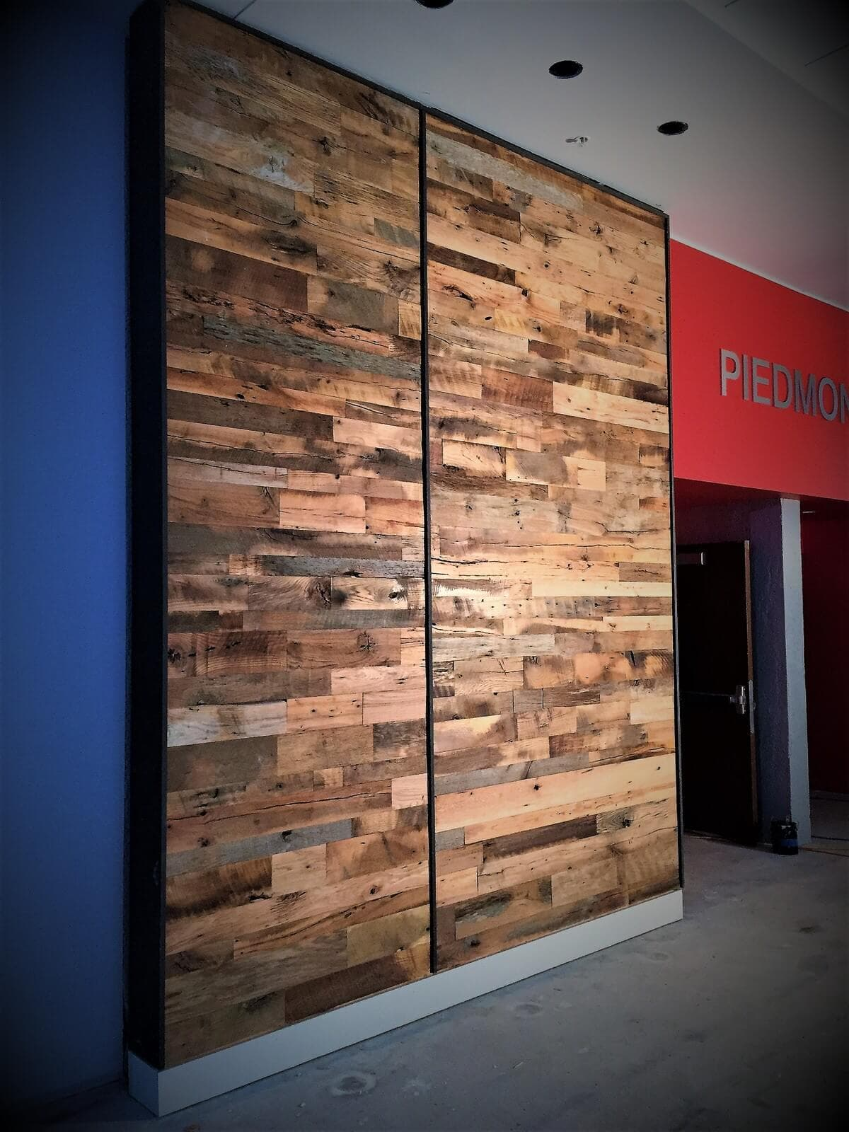 Reclaimed hardwood accent wall at the Bayer Bldg in raleigh, nc