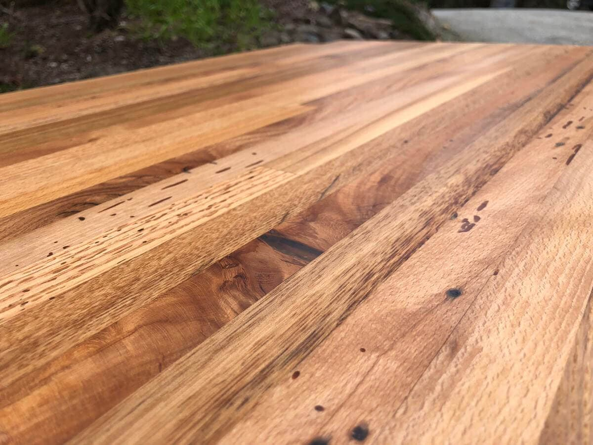 closeup of reclaimed mixed hardwood countertop ready to get installed.