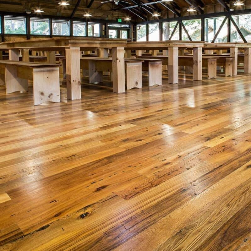 Reclaimed hardwood flooring in Whole Log classic style.