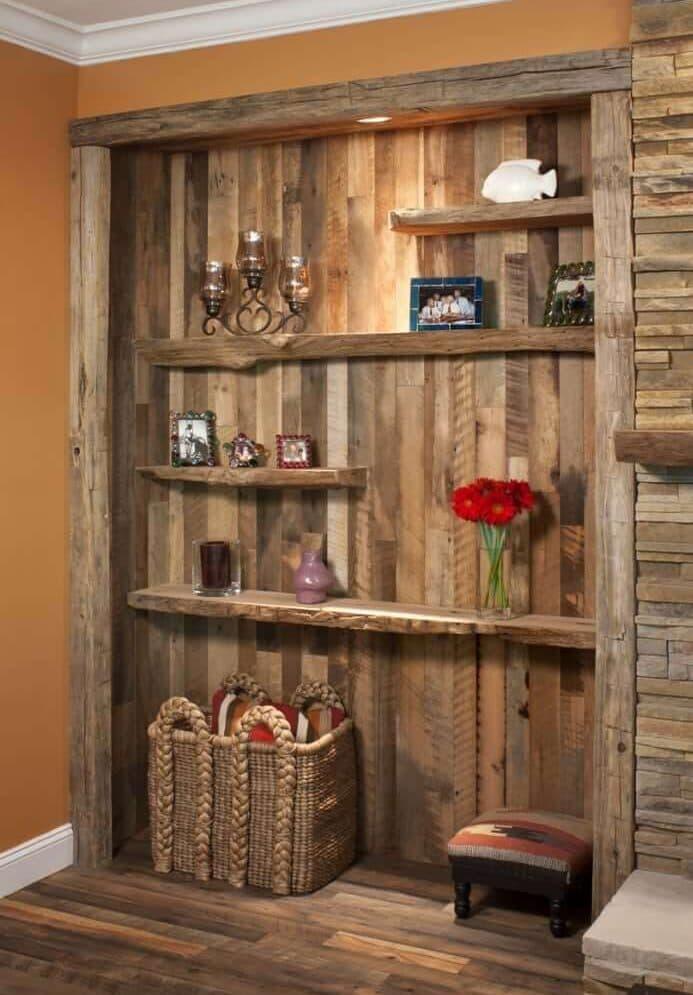 Reclaimed wood wall cladding bookshelf accent wall in Flat Rock North Carolina home.