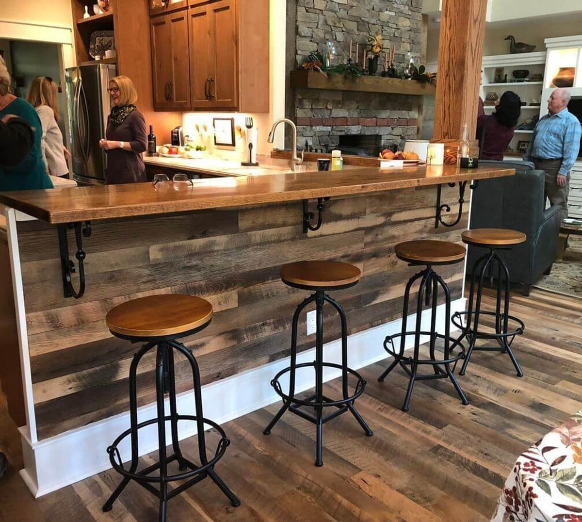 Reclaimed wood bar top in home kitchen.