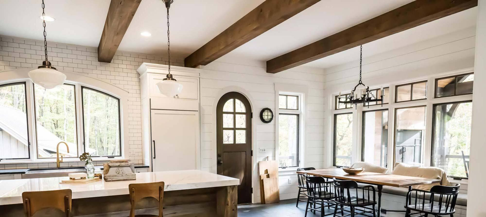 Stunning rustic reclaimed ceiling beams in kitchen.