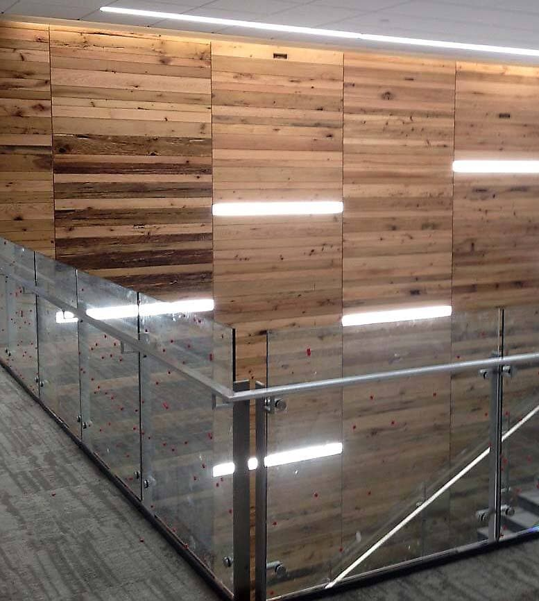 Reclaimed wood for oak accent wall in Durham North Carolina Bayer building.