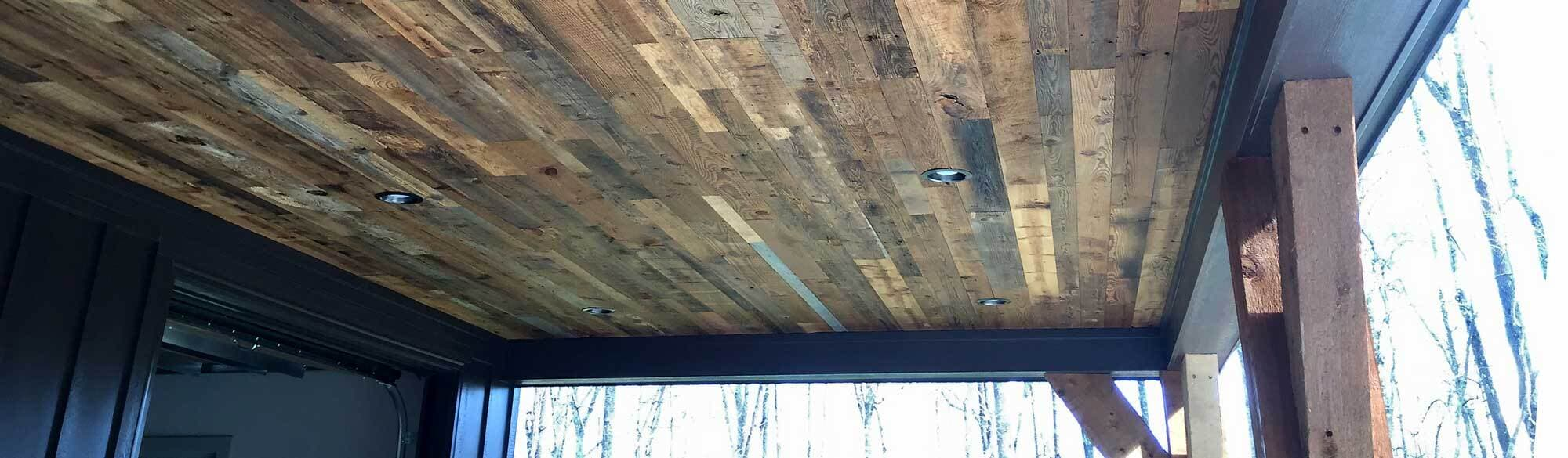 Reclaimed wood for rustic porch ceiling.
