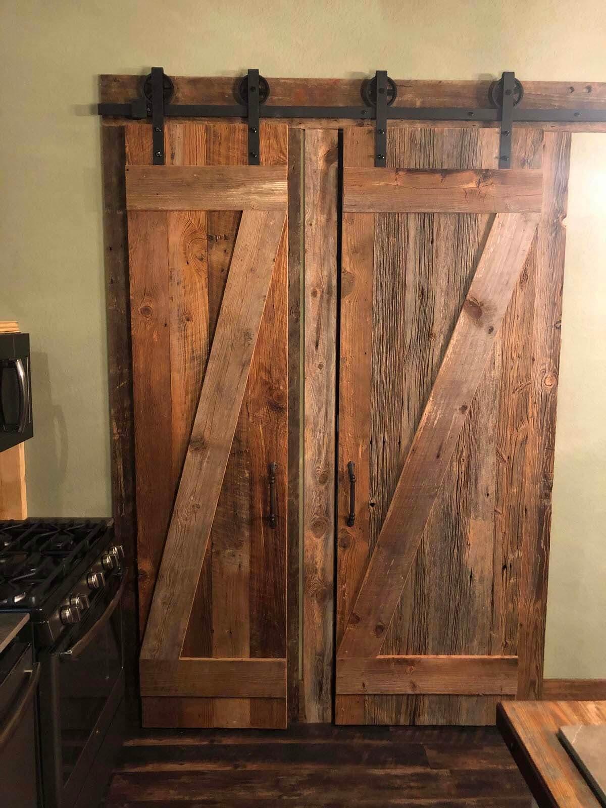 Rustic sliding barn door made from reclaimed wood.