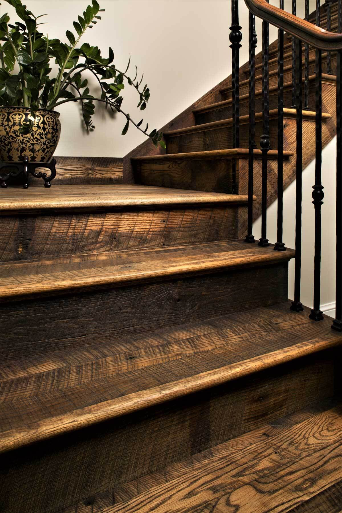 Reclaimed wood stair tread from reclaimed Oak creates beautiful staircase in Black Mountain North Carolina.